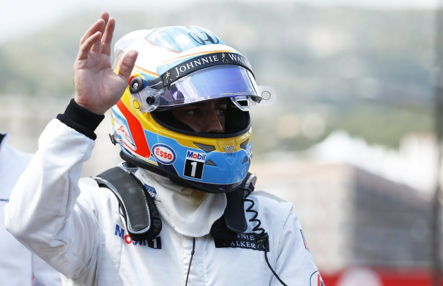 Fernando Alonso waves to the fans.